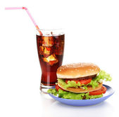 Big and tasty hamburger on plate with cola isolated on white — Stock Photo