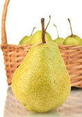 Fresh pears in wicker basket on white background close-up — Stock Photo