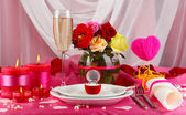 Ring in gift box on celebratory table of Valentine's Day on white fabric background — Foto de Stock