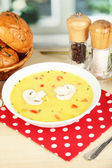 Fragrant soup in white plate on table on window background close-up — Stock Photo