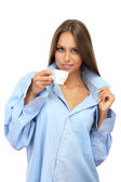 Beautiful young woman with cup of coffee, isolated on white — Stock Photo