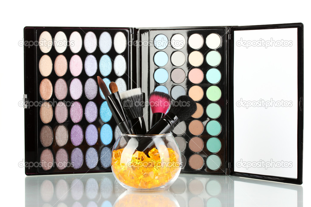 Make-up brushes in a bowl with stones on palette of shadows background — Stock Photo #14333171