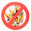 Cigarette butts with prohibition sign isolateed on white — Stock Photo #14340941
