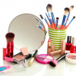 Cosmetics near mirror isolated on white — Stok fotoğraf
