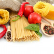 Pasta spaghetti, vegetables and spices, isolated on white — Стоковая фотография
