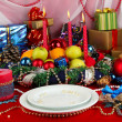 Serving Christmas table on white and red fabric background - Stock fotografie