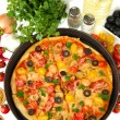 Colorful composition of delicious pizza, vegetables and spices on white background close-up - Stock Photo