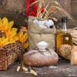 Different types of rye bread on wooden table on wooden background — Stock Photo
