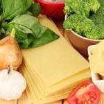 Lasagna ingredients on wooden background — Stock Photo