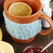 Helpful tea with jam for immunity on wooden table close-up — Stockfoto