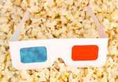 Cinema glasses on popcorn background — Stock Photo