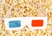Cinema glasses on popcorn background — Stock Photo
