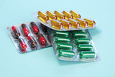 Capsules packed in blisters, on blue background — Stock Photo