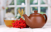 Tea with red viburnum on table on bright background — Stock Photo