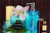 Beautiful spa setting on bamboo background with reflection — Stock Photo