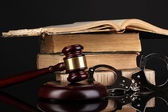 Gavel, handcuffs and books on law isolated on black close-up — Stock Photo