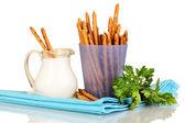 Tasty crispy sticks in purple plastic cup on yellow background — Stock Photo