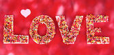 Word Love on red background — Stock Photo