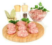 Raw meatballs with spices isolated on white — Stock Photo