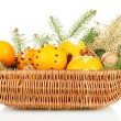 Christmas composition in basket with oranges and fir tree, isolated on white - Stock Photo