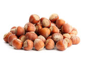 Tasty hazelnuts, isolated on white — Stock Photo
