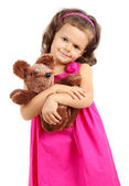 Beautiful little girl with toy bear isolated on white — Stock Photo