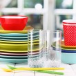 Colorful tableware on wooden table on window background — Stock Photo #14500691