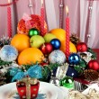 Serving Christmas table on white fabric background — Stock Photo #14500811