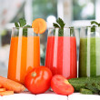 Fresh vegetable juices on wooden table, on window background — Stock Photo #14501283