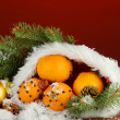 Royalty-Free Stock Photo: Christmas composition with oranges and fir tree in Santa Claus hat