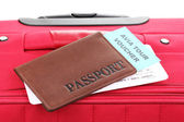Passport and ticket on suitecase close-up — Stock Photo
