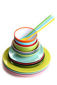 Many colorful plates isolated on white — Stock Photo
