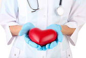 Doctor with heart in hand. isolated on white — Stock Photo