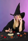 Witch with crystal ball. Fortune telling. On color background — Stock Photo