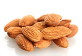Tasty almonds nuts, isolated on white — Stockfoto