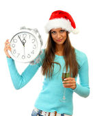 Beautiful young woman with clock and glass of champagne, isolated on white — Stock Photo