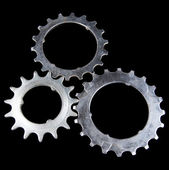 Metal cogwheels on black background — Stock Photo