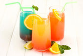 Three cocktails on white background — Stock Photo