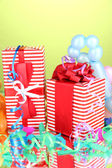 Colorful gift boxes on green background — Stock Photo