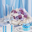 Serving fabulous wedding table in blue color on blue and white fabric background — Stock Photo #14574917