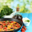 Colorful composition of delicious pizza, vegetables and spices on blue wooden background close-up - Стоковая фотография