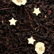 Aromatic black dry tea with flowers, close up — Stock Photo