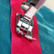 Closeup of sewing machine working part with  blue cloth — ストック写真