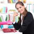 Young pretty business woman with phone and notebook working at office. Contact us — Stock Photo #14576573