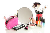 Cosmetics near mirror isolated on white — Stock Photo