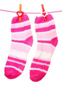 Pair of striped socks hanging on a rope isolated on white — Stock Photo