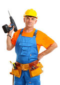 Male builder with drill in hand isolated on white close-up — Stock Photo