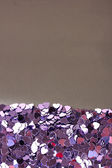 Hearts confetti on gray background — Stock Photo