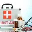 Stock Photo: First aid box, on blue background