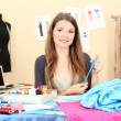 Beautiful young dressmaker in workroom — Stock Photo #14615575
